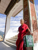 Monk leaning on a trash bin — Stock Photo