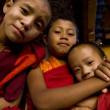 Young buddhist monks posing in front of Divine Madman's fertility temple the Chimi Lhakhang — Foto Stock