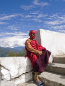 Buddhist monk with spiderman mask on — Stock Photo