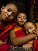Young buddhist monks posing in front of Divine Madman's fertility temple the Chimi Lhakhang — Stock Photo