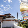 Temple in Bhutan with colorful prayerflags — Stock Photo