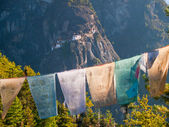 View of the Taktshang monastery in Paro (Bhutan) with prayer flags in front — Stock Photo