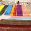 Stock Photo: Colorful cloth laying to dry on ghats at Ganges river