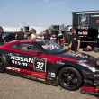 Постер, плакат: A Nissan GT R NISMO GT3 is stalled behind the pitlane