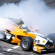 Tom Coronel burns some rubber in a Formula car in Zandvoort — Stock Photo