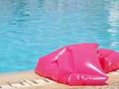 Air mattress at the poolside — Stock Photo
