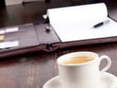 Leather folder with blank paper and a cup of coffee — Stok fotoğraf