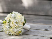Beautiful wedding bouquet with white flowers — Stock Photo