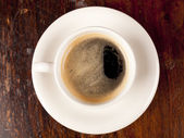 Top view of a cup of dark roasted coffee — Stock Photo