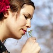 Beautiful girl smelling a cuckoo flower in the spring — Stock Photo #44805213