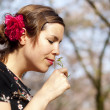 Beautiful girl smelling a cuckoo flower in the spring — Stock Photo #45704631