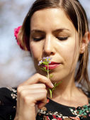 Beautiful girl smelling a cuckoo flower in the spring — Stock Photo