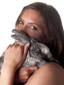 Smiling beautiful brunette holding and petting her bunny — Foto Stock