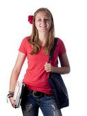 Young female teenage student carrying books over a white background — 图库照片