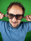 Thirty year old man with 3d glasses is too afraid to watch the movie — Stock Photo