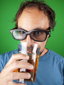 Thirty year old man with 3d glasses drinking while watching a movie — Stock Photo