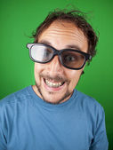 Thirty year old man with 3d glasses is watching a funny movie — Stock Photo