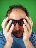 Thirty year old man with 3d glasses is too afraid to watch the scary movie — Stock Photo