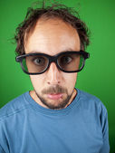 Thirty year old man with 3d glasses watching a sad movie — Stock Photo