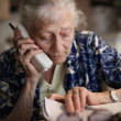 Stock Photo: Senior womtalking on phone