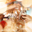 Hands holding the glasses of champagne — Stock Photo #32419293