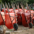 Stock Photo: Wheelbarrows in garden