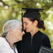 Happy graduate with grandmother celebrating graduation — Stock Photo #32419469