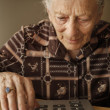 Senior woman using calculator — Stock Photo