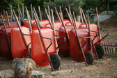 Wheelbarrows in garden — Stock Photo