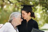 Happy graduate with grandmother celebrating graduation — Fotografia Stock