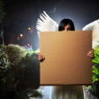 Angel with cardboard sign — Stock Photo