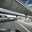 Driving under overpass — Stock Photo