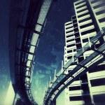 Futuristic monorail bridge around skyscrapers — Stock Photo