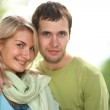 Happy young couple in park. — Stock Photo