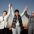 Three women raising hands — Stock Photo