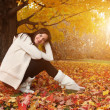 Young woman in autumn park. — Stock Photo