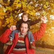 Father and son in autumn park — Stock Photo #32421441