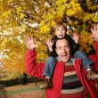 Stock Photo: Father and son in autumn park