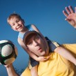 Stock Photo: Father with son playing ball