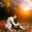 Beautiful young womin autumn park. — Stock Photo #32421531