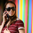 Beautiful girl in sunglasses talkng on cell phone — Stockfoto