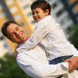 Stock Photo: Father with son outdoors.