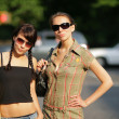 Two beautiful girls in sunglasses — Stock Photo