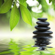 Zen stones pyramid on water surface — Stock Photo #32422367