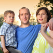 Stock Photo: Portrait of a young family