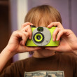 Boy with photo camera — Stockfoto