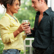 Stock Photo: Beautiful adult couple with glasses of wine