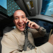 Businessman driving in car and talking on cell phone. — Stock Photo