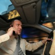 Businessman driving in car — Stockfoto