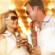 Adult couple enjoying nightlife with glasses of champagne — Stock Photo #32423793
